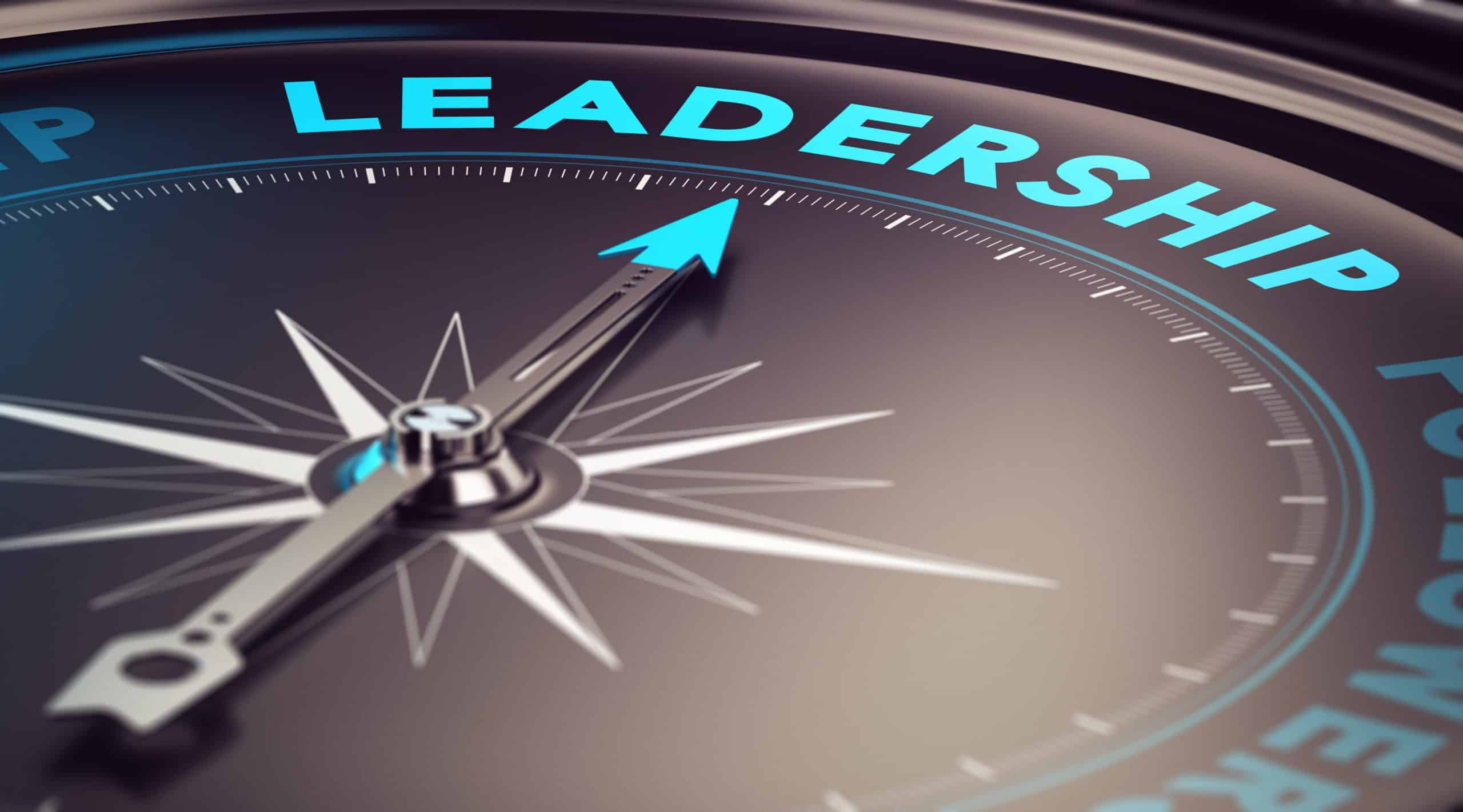 Compass with needle pointing the word leadership with blur effect plus blue and black tones. Conceptual image for illustration of leader motivation